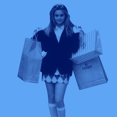 "Light blue background with Alicia Silverstone from the movie ""Clueless"" holding shopping bags"