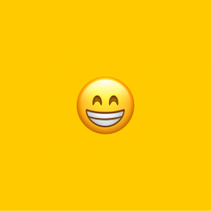 yellow background with grinning face with smiling eyes emoji on it