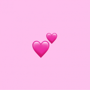 pink background with two hearts emoji on it