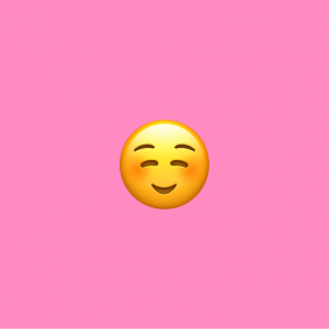 pink background with white smiley emoji on it