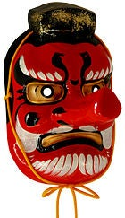 3D mask in red with a giant nose, menacing face, black hair at the top and a white beard