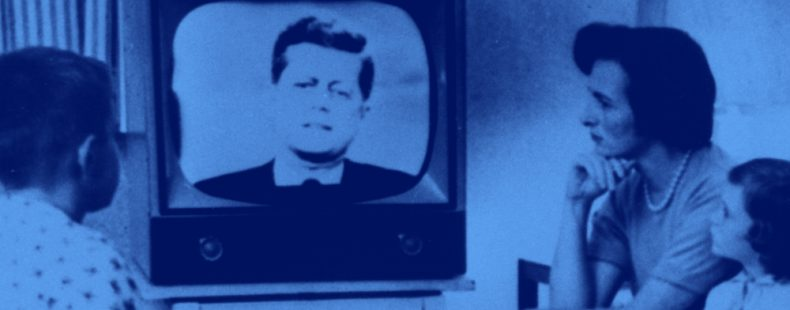 image of family watching JFK on the television