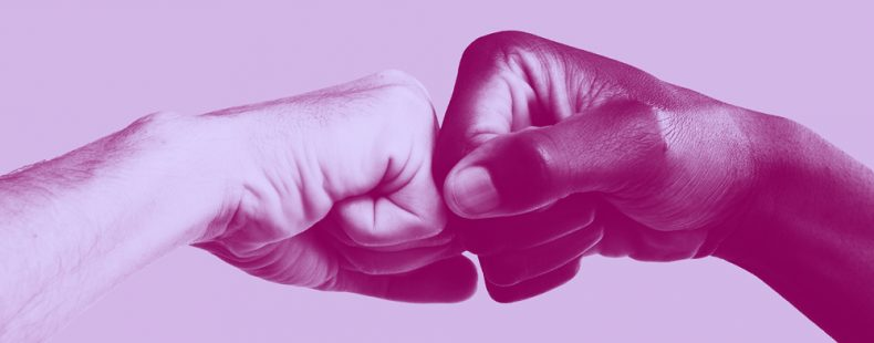 two hands fist-bumping