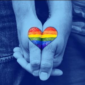 holding hands LGBTQIA rainbow flag heart on them